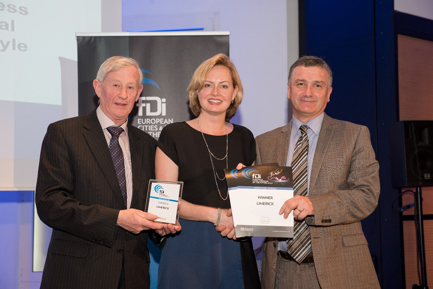 Courtney Fingar, editor-in-chief, FDi magazine presents Cllr Noel Gleeson and Pat Fitzgerald, Limerick City and County Council, with Limerick's European City of the Future award.